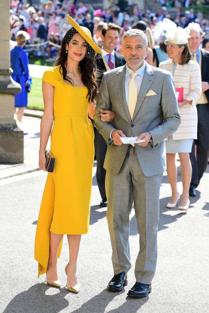 Amal Clooney wearing Stella McCartney and a Stephen Jones hat..jpg